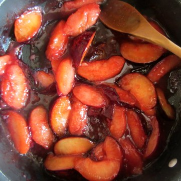 Plum cobbler cooked plum slices